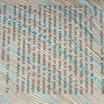 diagonales bleues et noires sur livre de poche Elize