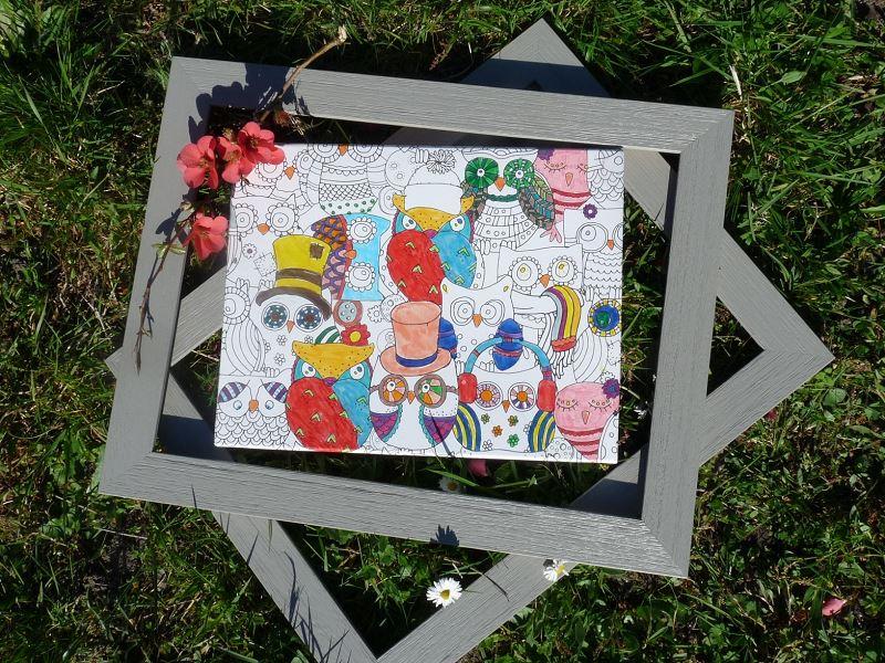 coloriage enfant dans l'herbe hibou